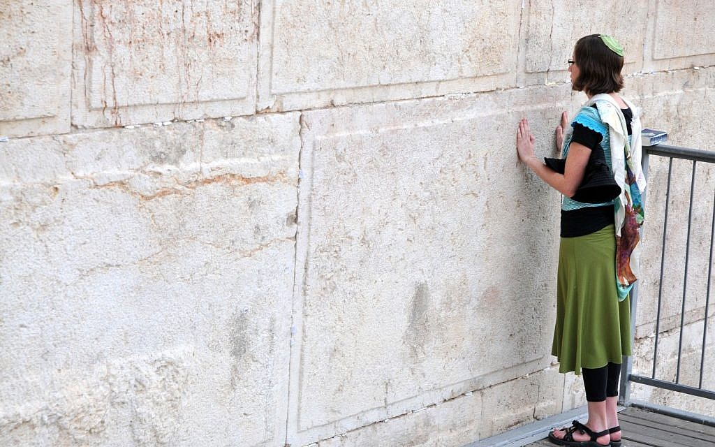 A member of Women of the Wall, wearing a tallit and kipa during prayer (photo credit: Sophie Gordon/Flash90)