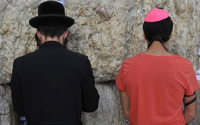 A Haredi and a secular Jew praying at the Western Wall in Jerusalem. (Serge Attal/Flash90)