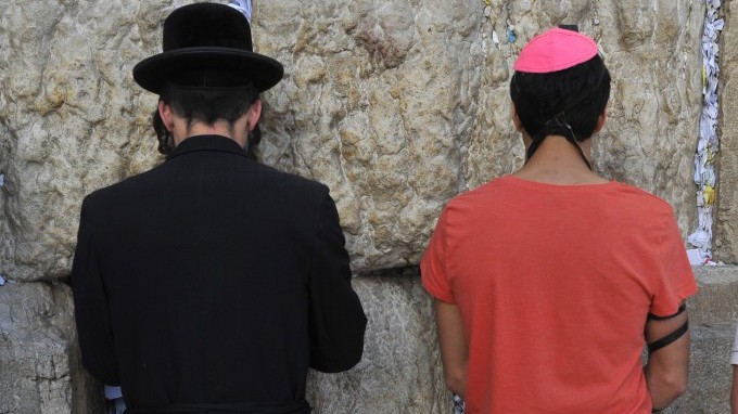 Haredi and secular Jews praying at the Western Wall in Jerusalem. American Jews are increasingly less able to affiliate religiously. (photo credit: Serge Attal/FLASH90)