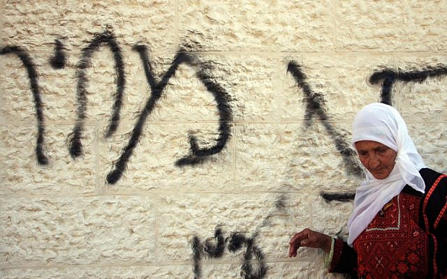 Graffiti on a West Bank mosque reading 'price tag' in Hebrew (Illustrative photo: Issam Rimawi/Flash90)