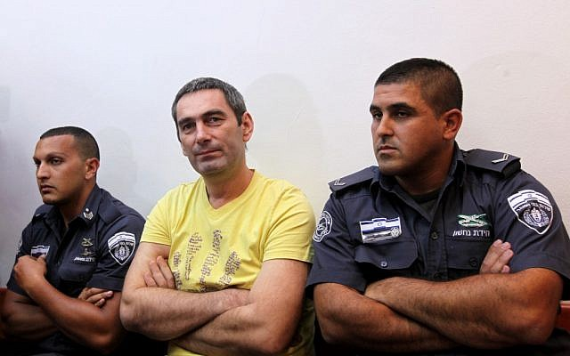 Aleksander Cvetkovic (center) in court, August 2011 (photo credit: Kobi Gideon/Flash90)