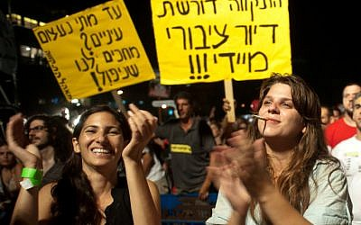Dafni Leef, right, one of the leaders of last year's social protest, in Tel Aviv last September (photo credit: Jorge Novominsky/Flash90)