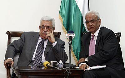 PA President Mahmoud Abbas (left) and chief negotiator Saeb Erekat (photo credit: Uri Lenz/Flash90)