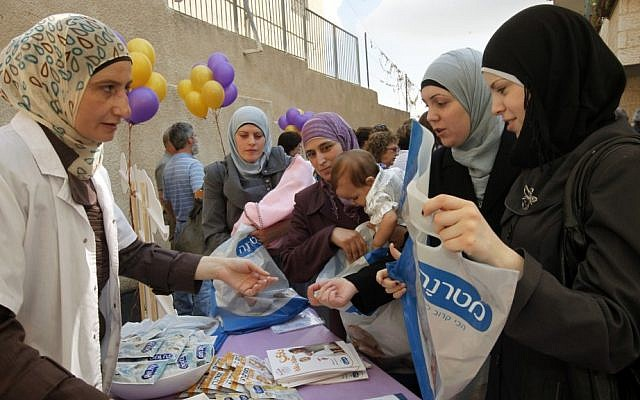 Arab women attend the opening of a new infant care clinic in east Jerusalem in 2011. ( Miriam Alster/Flash90)
