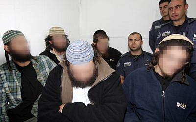 Young right-wing extremists sit in the Magistrate's Court in Jerusalem, arrested for suspicion of involvement in 'Price Tag' actions in December 2011 (photo credit: Miriam Alster/Flash90)