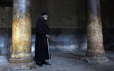 A Christian Orthodox monk tours the Church of Nativity in the West Bank town of Bethlehem in January (photo credit: Issam Rimawi/Flash90)