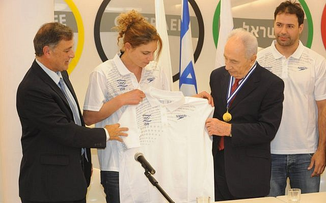 President Shimon Peres met with athletes training for the upcoming Olympic Games in January 2012. Peres is seen with Lee Korzits (second from left) and Arik Zeevi (right). (photo credit: Mark Nayman/GPO/Flash90)