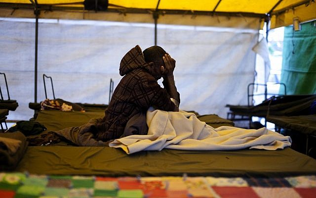A Sudanese asylum-seeker in Levinsky Park in February (photo credit: Dima Vazinovich/Flash90)