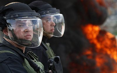 Illustrative photo of Israeli security officers in riot gear. (photo credit: Uri Lenz/Flash90)