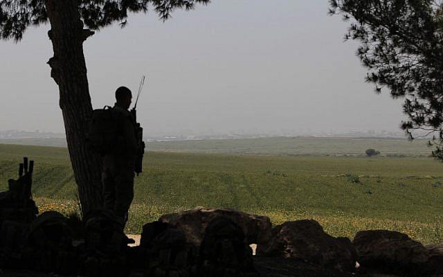 An Israeli soldier guarding near the Gaza border in April. (photo credit: Tsafrir Abayov/Flash90)