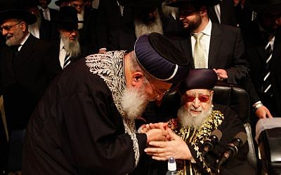 Late Shas spirtual leader Rabbi Ovadia Yosef (seated) and Chief Sephardi Rabbi Shlomo Amar during a Shas party Passover gathering, April 2012. (photo credit: Uri Lenz/Flashh90)