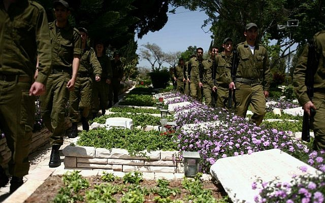Soldiers at the military cemetery of Mt. Herzel, April 2012 (photo credit: Yehoshua Yosef/Flash90)
