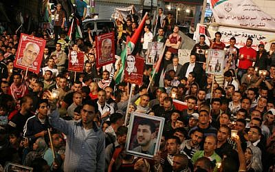 Palestinians celebrating the announcement in May 2012 that prisoners had ended a hunger strike after striking a deal with Israeli authorities. (photo credit: Issam Rimawi/Flash90)