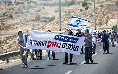 Hundreds of residents of the Ulpana illegal outpost in Beit El during a two-day protest march in early June. (photo credit: Noam Moskowitz/Flash90)