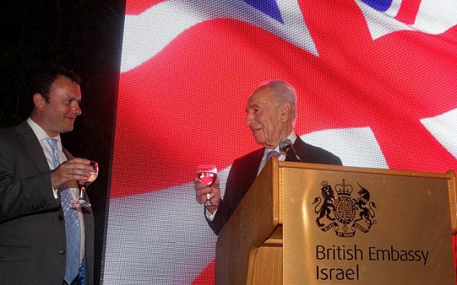 Britain's Ambassador to Israel Matthew Gould and President Shimon Peres toast Queen Elizabeth II at an event marking her Diamond Jubilee (photo credit: Roni Schutzer/Flash90)