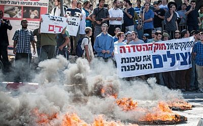 Protesters at the entrance to Jerusalem after the bill was rejected in the Knesset on Wednesday (Photo credit: Noam Moskowitz/ Flash 90)