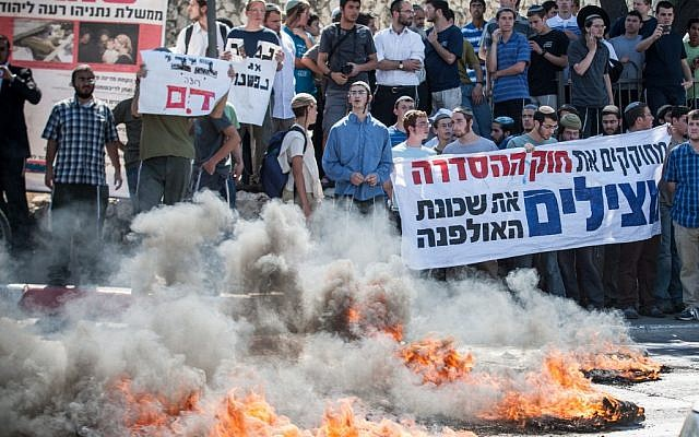 RIght-wing protesters burn fires at the entrance to the Jerusalem on Wednesday. (photo credit: Noam Moskowitz/Flash90)