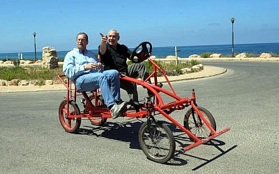 Prime Minister Benjamin Netanyahu and journalist Peter Greenberg on a bike. (photo credit: Avi Ohayon/Flash90)