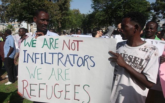 A group of South Sudanese refugees gather in Tel Aviv to protest against a deportation in June. (photo credit: Roni Schutzer/Flash90)