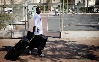Illustrative photo: A South Sudanese migrant prepares last week to leave Israel (photo credit: Tali Mayer/Flash90)