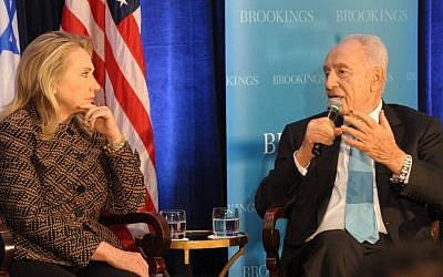 US Secretary of State Hillary Clinton and President Shimon Peres speak about the Middle East at the Brookings Institution's 12th anniversary in Washington in June (photo credit: Amos Ben Gershom/GPO/Flash90)