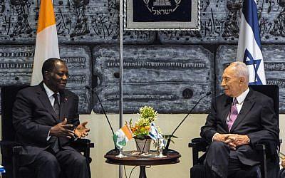 Alassane Ouatttara and Shimon Peres, on Sunday (photo credit: Moshe Milner/GPO/Flash90)