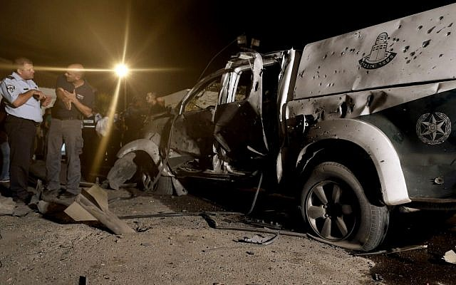 Police examine the scene of a Qassam landing near kibbutz Yad Mordechai, June 19 (photo credit: Tsafrir Abayov/Flash90)