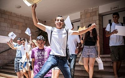 High school students in Jerusalem seen with their report cards on their last day of school. (Photo credit: Noam Moskowitz/Flash90