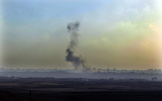 Smoke is seen from the Israeli side of the Israel Gaza border in southern Israel after an air strike by Israeli air force on Hamas base in the Gaza Strip in June (photo credit: Tsafrir Abayov/Flash90)