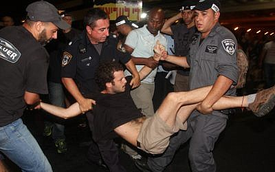 Police arrest protesters during a rally in Tel Aviv Saturday (photo credit: Roni Schutzer/Flash90)