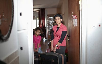 One of the 33 families who will be forced to leave their home in Givat Ulpana packing the belongings before their eviction on Tuesday. (photo credit: Noam Moskowitz/Flash90)