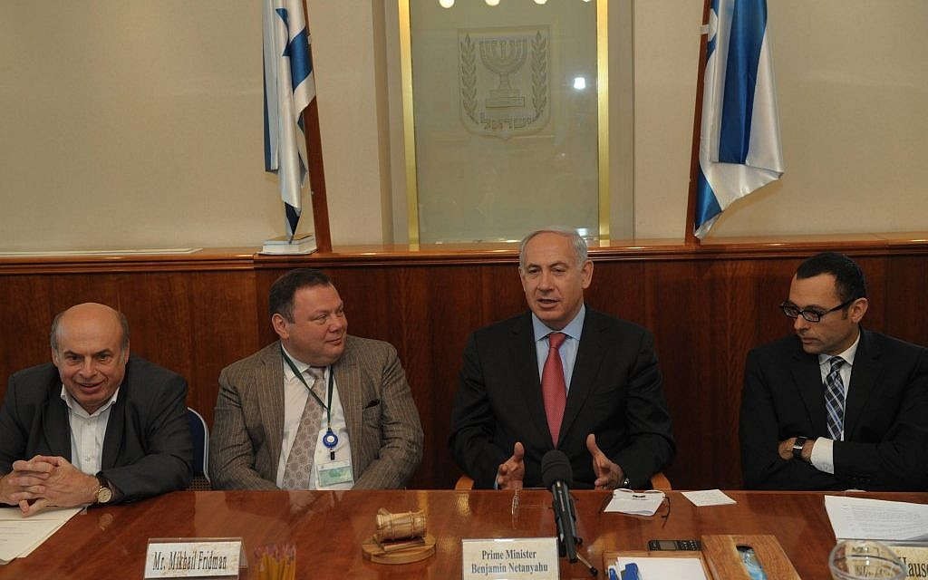 Left to right: Jewish Agency chairman Natan Sharansky, Genesis Philanthropy Group chairman Mikhail Fridman, Prime Minister Benjamin Netanyahu and Cabinet secretary general Tzvi Hauser (photo credit: Amos Ben Gershom/Flash90)