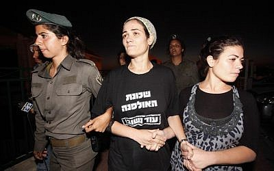 The Fattal family being forcibly evacuated from the Ulpana outpost in the West Bank settlement of Beit El (photo credit: Miriam Alster/Flash90)