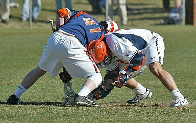 Face-off in a US college lacrosse match (photo credit: CC-BY 2.0, by Yarnalgo, Wikimedia Commons)