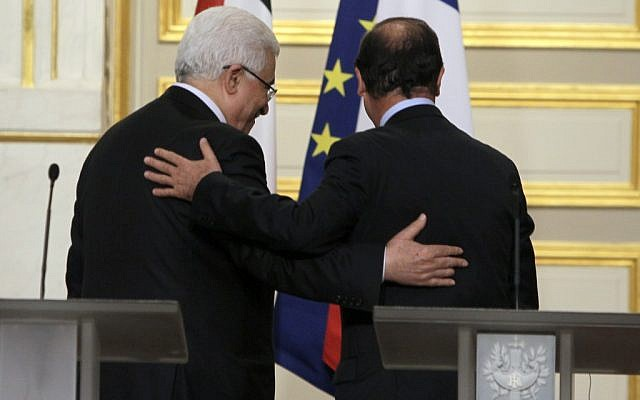 French President Francois Hollande, right, and Palestinian President Mahmoud Abbas leave after a press conference following their meeting at the Elysee Palace in Paris in June, 2012. (photo credit: AP/Francois Mori)