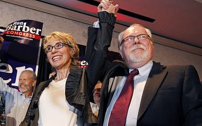 Gabriella Giffords and her replacement Ron Barber in June. (photo credit: AP/Ross D. Franklin, pool)