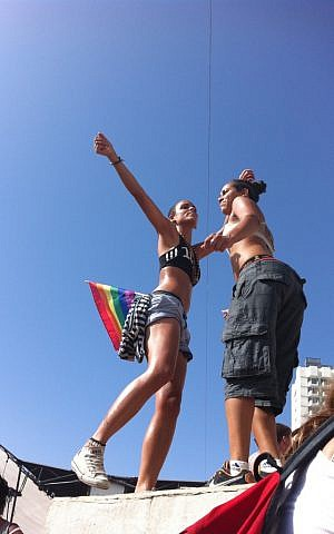 A couple dances at the 2011 gay pride parade after-party at Gordon Beach in Tel Aviv (photo credit: Michal Shmulovich)