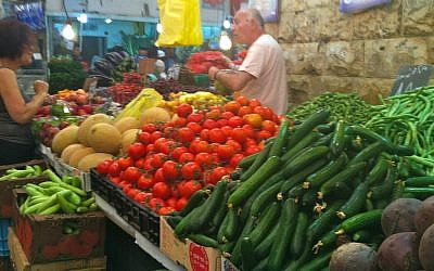 Bargaining at a vegetable stall in the shuk (photo credit: Tracy Fryberg)