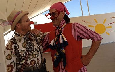 Two clowns greet visitors at the Jordan River Village's grand opening Sunday (photo credit: Michal Shmulovich)