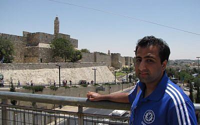 Kasim Hafeez stands outside Jerusalem's Old City (photo credit: Elhanan Miller/ Times of Israel)