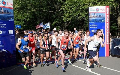 More than 5,000 runners participated in the second annual New York Road Runners Celebrate Israel Run in Manhattan's Central Park. The 4-mile run was organized as a symbolic journey through Israel, from Eilat to Tel-Aviv. (photo credit: David Karp)