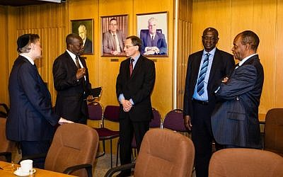 Prof. Eugene Kandel, director of Israel's National Economic Council (center) discusses key issues with (left to right) Africa's Voices in Israel mission leader, Michael Landau, Ghana's Central Bank Governor Prof. Kwesi Bekoe Amissah Arthur, South Sudan's Central Bank Governor Prof. Kornelio Koriom Mayik, and Swaziland's Central Bank Governor Prof. Martin Dlamini. (photo credit: David Katz/Africa's Voices in Israel)
