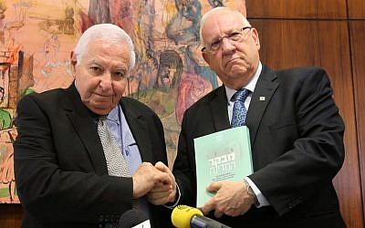 Then-state comptroller Micha Lindenstrauss submits his report on the Carmel forest fire to then-Knesset speaker Reuven Rivlin, June 2012. (Miriam Alster/Flash90)