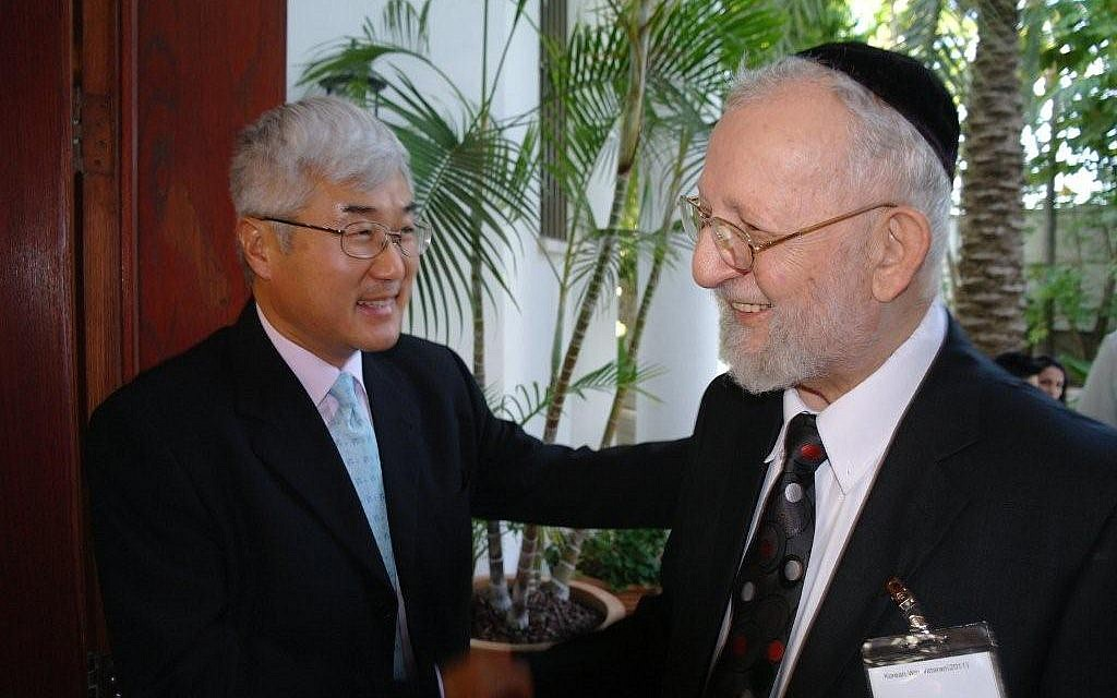 Ma Young-Sam, left, until last year South Korea's ambassador to Israel, says he feels 'so fortunate' to have paid tribute to American Jewish ex-soldiers like Leonard Wisper, who he is greeting here. (photo credit: Courtesy Embassy of South Korea in Israel/JTA)