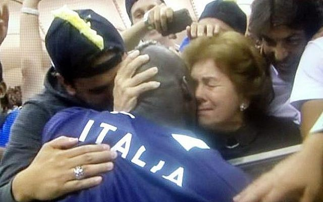Italy's goal-scorer Mario Balotelli hugs his Jewish foster mother Silvia after Thursday's victory over Germany at Euro 2012. (via Twitter)