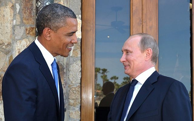US President Barack Obama greets Russia's President Vladimir Putin at the G-20 Summit in Los Cabos, Mexico, June 2012. (photo credit: AP/Alexei Nikolsky/RIA-Novosti)