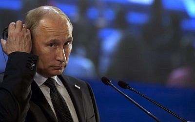 Russia's President Vladimir Putin (photo credit: AP/Esteban Felix)