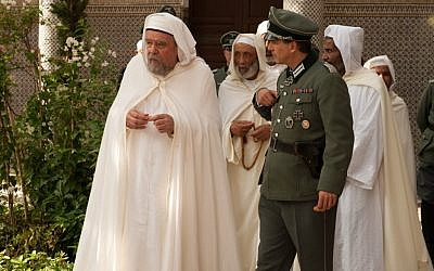 Michael Lonsdale plays Ben Ghabrit (in white) seen here at the Paris Mosque. (photo credit: Courtesy)