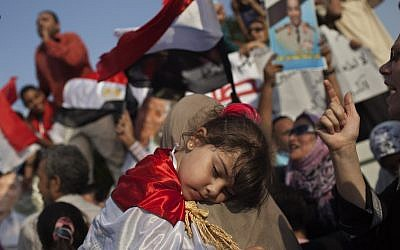 An Egyptian girl sleeps during a pro-Shafiq rally in Cairo Saturday (photo credit: AP Photo/Bernat Armangue)