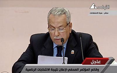Judge Farouk Sultan, chairman of Egypt's election committee, announces the result of the presidential election at the State Information Service headquarters in Cairo, Egypt. (photo credit: AP/Egypt State TV) MANDATORY CR